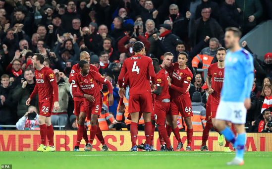 20832426-7670275-Liverpool_s_team_celebrates_their_third_goal_of_the_evening_amid-a-16_1573412753323